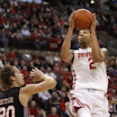 Ohio State's Marc Loving, right, goes up for a shot against Campbell's Andrew Ryan during the first half of an NCAA college basketball game in Columbus, Ohio, Wednesday, Nov. 26, 2014. ( AP Photo/Paul Vernon)