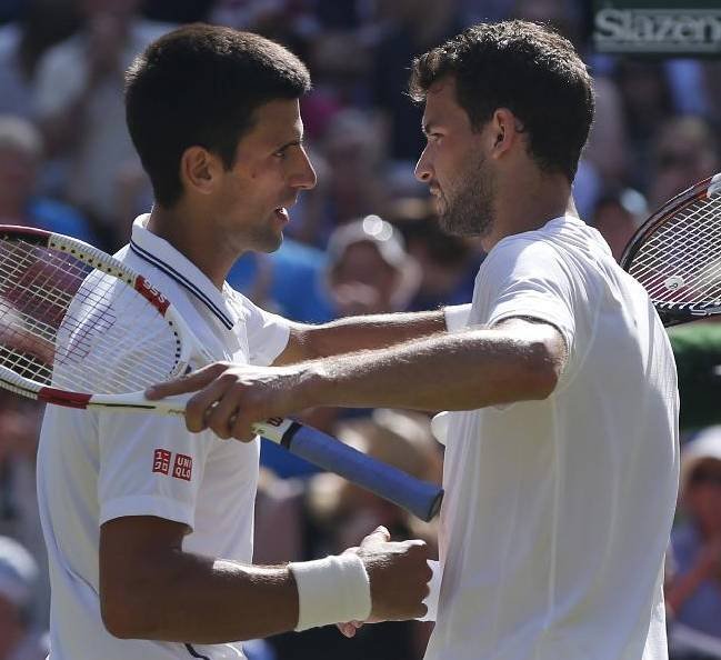 Novak Djokovic of Serbia, left, shakes hands with Grigor Dimitrov of Bulgaria after he defeated him in their men's singles semifinal match at the All England Lawn Tennis Championships in Wimbledon, London, Friday, July 4, 2014