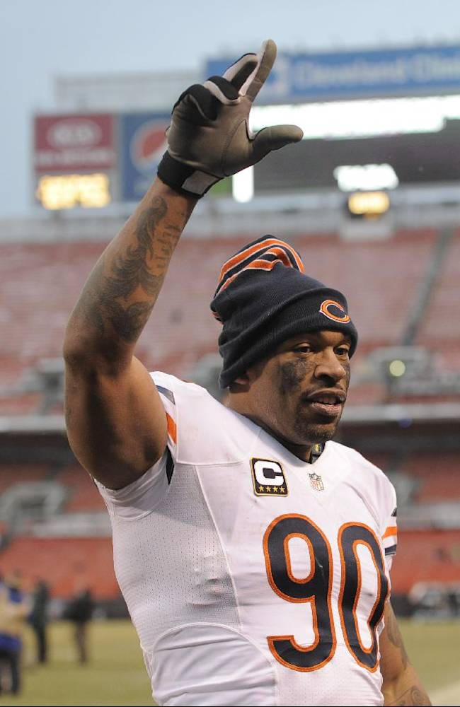 Chicago Bears defensive end Julius Peppers walks off the field after an NFL football game against the Cleveland Browns Sunday, Dec. 15, 2013, in Cleveland. Chicago won 38-31
