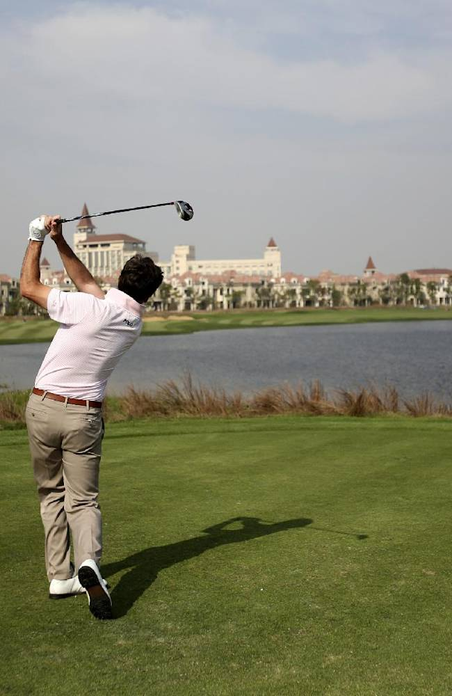 Spain's Gonzalo Fernandez-Castano tees off on the 9th hole during the final round of the BMW Masters golf tournament at the Lake Malaren Golf Club in Shanghai, China, Sunday, Oct. 27, 2013