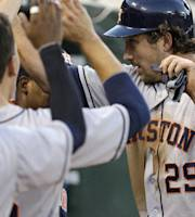 Houston Astros' Brett Wallace (29) is congratulated after scoring against the Oakland Athletics in the third inning of a baseball game Tuesday, Aug. 13, 2013, in Oakland, Calif. Wallace scored on a double by Chris Carter. (AP Photo/Ben Margot)
