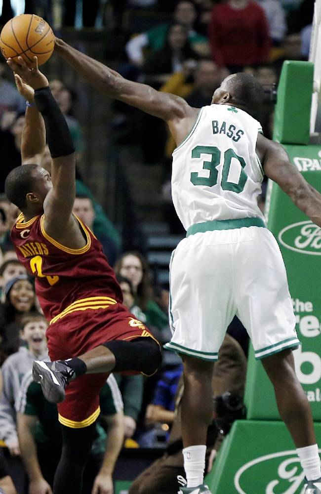 Boston Celtics' Brandon Bass (30) blocks a shot by Cleveland Cavaliers' Dion Waiters (3) with seconds left on the clock in the third quarter of an NBA basketball game in Boston, Saturday, Dec. 28, 2013. The Celtics won 103-100