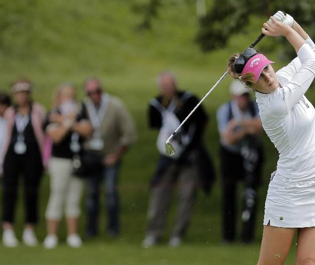 Sandra Gal, of Germany, plays on the 18th hole during the second round of the Evian Championship women's golf tournament in Evian, eastern France, Saturday, Sept. 14, 2013