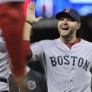 Boston Red Sox' Cody Ross celebrates after the Red Sox beat the Minnesota Twins 6-5 in a baseball game Monday, April 23, 2012, in Minneapolis. Ross had three RBI and two home runs. (AP Photo/Jim Mone)