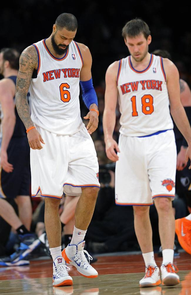 New York Knicks' Tyson Chandler (6) and Beno Udrih react during the fourth quarter of an NBA basketball game against the Memphis Grizzlies Saturday, Dec. 21, 2013, at Madison Square Garden in New York. The Grizzlies defeated the Knicks 95-87