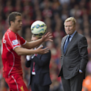 Southampton's manager Ronald Koeman, right, stands on the touchline as his side are beaten 2-1 at Liverpool, during their English Premier League soccer match at Anfield Stadium, Liverpool, England, Sunday Aug. 17, 2014