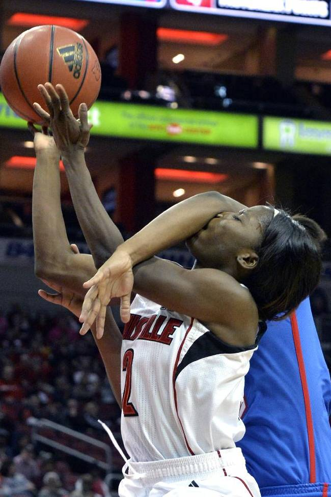 Louisville's Monny Niamke, front, is fouled by SMU's Brittney Hardy during the second half of an NCAA women's college basketball game, Sunday, Dec. 29, 2013, in Louisville, Ky. Louisville defeated SMU 71-51