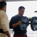 Arizona Cardinals' Bradley Sowell, right, adds more weight to the bar as he works out with teammate Jared Veldheer during the first phase of the voluntary offseason training program at the NFL football team's training facility, Thursday, April 24, 2014, i