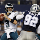 Philadelphia Eagles quarterback Mark Sanchez (3) prepares to pass as teammate Lane Johnson, right, helps against a rush by Dallas Cowboys' Jeremy Mincey (92) during the second half of an NFL football game, Thursday, Nov. 27, 2014, in Arlington, Texas The
