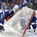 Detroit Red Wings center Pavel Datsyuk (13), of Russia, is pinned to the back of the goal by Tampa Bay Lightning right wing Ryan Callahan (24) and defenseman Andrej Sustr (62), of the Czech Republic, during the third period of an NHL hockey game Thursday,