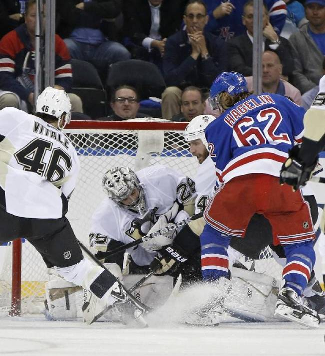 Pittsburgh Penguins center Joe Vitale (46) and teammates help goalie Marc-Andre Fleury (29) defend the crease with New York Rangers left wing Carl Hagelin (62) threatening in the third period of their second-round NHL Stanley Cup hockey playoff game at Madison Square Garden in New York, Monday, May 5, 2014.  The Penguins shutout the Rangers 2-0 to take a 2-1 lead in the series
