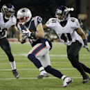 New England Patriots wide receiver Danny Amendola (80) runs between Baltimore Ravens defensive back Rashaan Melvin (38) and Baltimore Ravens cornerback Anthony Levine (41) after catching a pass in the first half of an NFL divisional playoff football game