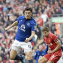 Everton's Gareth Barry attempts a shot on goal during their English Premier League soccer match against Liverpool at Anfield in Liverpool, England, Saturday Sept. 27, 2014.