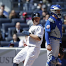New York Yankees' Brett Gardner looks to first as he scores on Jacoby Ellsbury's fifth-inning ground out to Chicago Cubs starting pitcher Jason Hammel in Game 1 of an interleague baseball doubleheader at Yankee Stadium in New York, Wednesday, April 16, 20