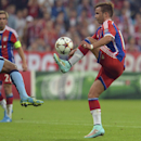 Bayern's Mario Goetze kicks the ball during the Champions League group E soccer match between Bayern Munich and Manchester City in Munich, Germany, Wednesday Sept.17,2014