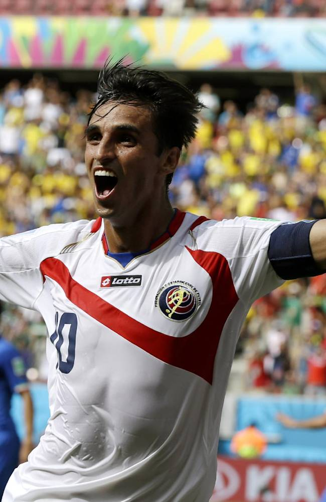 Costa Rica's Bryan Ruiz celebrates after scoring his side's first goal over Italy's goalkeeper Gianluigi Buffon during the group D World Cup soccer match between Italy and Costa Rica at the Arena Pernambuco in Recife, Brazil, Friday, June 20, 2014