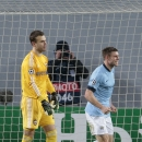 Manchester City's James Milner, right, celebrates after scoring the second goal during the Champions League Group E soccer match between CSKA Moscow and Manchester City at Arena Khimki stadium in Moscow, Russia, Tuesday Oct. 21, 2014