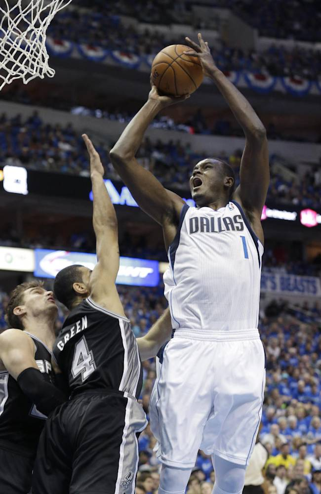 Dallas Mavericks center Samuel Dalembert (1) shoots over San Antonio Spurs guard Danny Green (4) and Tiago Splitter during the first half in Game 3 in the first round of the NBA basketball playoffs in Dallas, Saturday, April 26, 2014