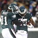 Philadelphia Eagles' LeSean McCoy, right, and Jason Avant celebrate after MCCoy's touchdown during the second half of an NFL football game, Sunday, Dec. 8, 2013, in Philadelphia. (AP Photo/Michael Perez)