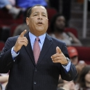 In this Nov. 10, 2012, photo, Houston Rockets assistant coach Kelvin Sampson talks to players during their NBA basketball game against the Denver Nuggets in Houston. The NCAA hit Sampson with a five-year