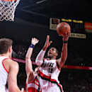 PORTLAND, OR - JANUARY 24: LaMarcus Aldridge #12 of the Portland Trail Blazers goes up for a shot against the Washington Wizards on January 24, 2015 at the Moda Center in Portland, Oregon. (Photo by Sam Forencich/NBAE via Getty Images)