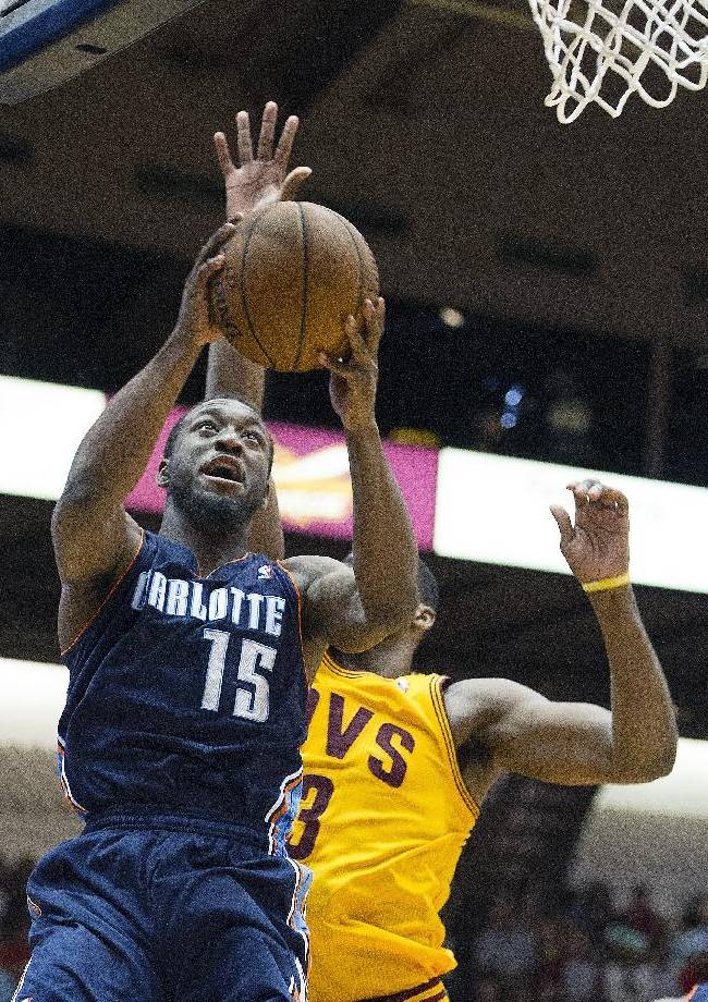 Charlotte Bobcats guard Kemba Walker (15) drives past Cleveland Cavaliers defender Tristan Thompson during the second quarter of an NBA preseason basketball game in Canton, Ohio, Tuesday, Oct. 15, 2013