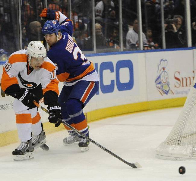 Philadelphia Flyers' Brayden Schenn drives the puck to the net past New York Islanders' Eric Boulton (36)in the first period of an NHL hockey game on Monday, Jan. 20, 2014, in Uniondale, N.Y