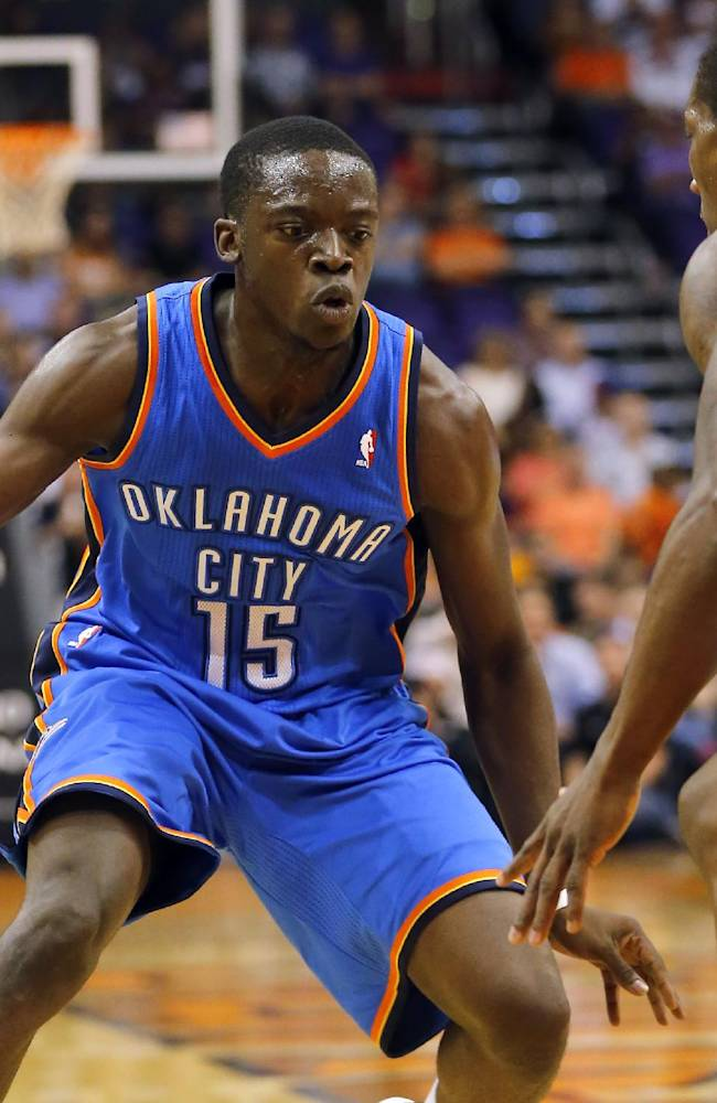 Oklahoma Thunder guard Reggie Jackson (15) drives against Phoenix Suns' Eric Bledsoe during the first half of an NBA preseason basketball game, Tuesday, Oct. 22, 2013, in Phoenix