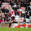 Sunderland's Craig Gardner, center, celebrates his goal during their English FA Cup fifth round soccer match against Southampton at the Stadium of Light, Sunderland, England, Saturday, Feb. 15, 2014