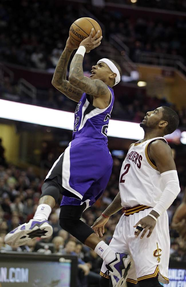 Sacramento Kings' Isaiah Thomas shoots inside Cleveland Cavaliers' Kyrie Irving (2) during the third quarter of an NBA basketball game Tuesday, Feb. 11, 2014, in Cleveland. The Cavaliers won 109-99