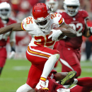 Kansas City Chiefs running back Jamaal Charles (25) breaks a tackle to score a touchdown against the Arizona Cardinals during the first half of an NFL football game, Sunday, Dec. 7, 2014, in Glendale, Ariz The Associated Press