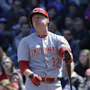 Cincinnati Reds' Jay Bruce reacts as he strikes out on a foul tip during the first inning of a baseball game against the Chicago Cubs in Chicago, Friday, April 18, 2014 The Associated Press