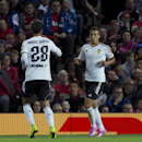 Valencia's Rodrigo Moreno, right, celebrates with teammate Andre Gomez after scoring against Manchester United during a pre season friendly soccer match at Old Trafford Stadium, Manchester, England, Tuesday Aug. 12, 2014