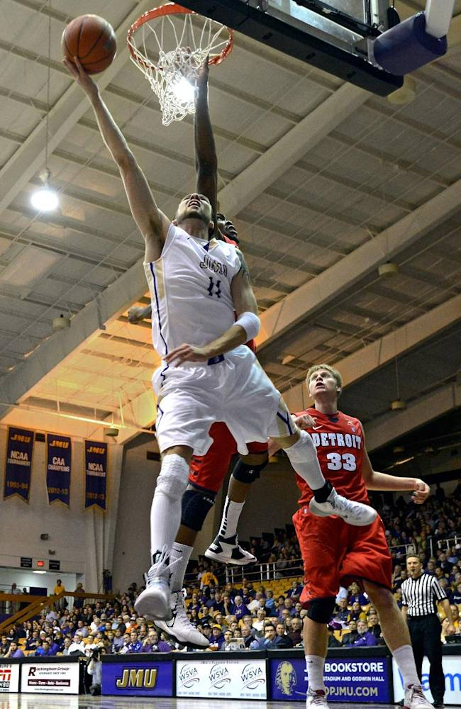 James Madison University's Andrey Semenov goes in for a layup in Tuesday's home opener against Detroit at the Convocation Center in Harrisonburg, Va
