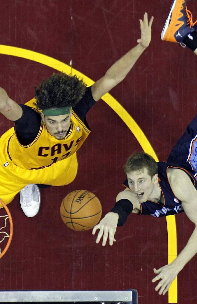 Charlotte Bobcats' Cody Zeller, right, shoots against Cleveland Cavaliers' Anderson Varejao, from Brazil, in the second half of an NBA basketball game on Saturday, April 5, 2014, in Cleveland