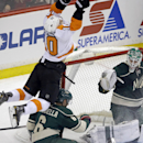 Philadelphia Flyers center Brayden Schenn (10) crashes into Minnesota Wild's Marco Scandella as goalie Josh Harding, right, looks on in the first period of an NHL hockey game, Monday, Dec. 2, 2013, in St. Paul, Minn The Associated Press