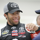 Darrell Wallace Jr. reacts with crew members after winning the pole position during qualifying for the NASCAR Trucks Series auto race, Friday, July 11, 2014, at Iowa Speedway in Newton, Iowa. (AP Photo/Charlie Neibergall)