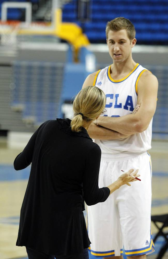 UCLA forward David Wear, right, talks to a reporter during the NCAA college basketball team's media day, Monday, Oct. 14, 2013, in Los Angeles