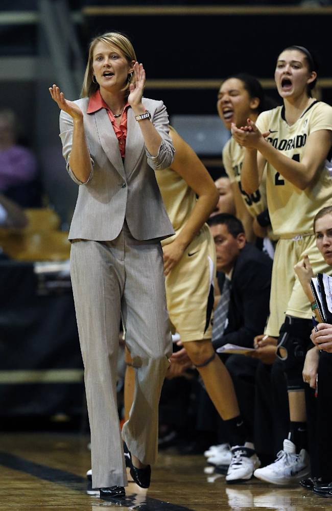 Colorado head coach Linda Lappe, left, urges on her team during an NCAA college basketball game against Denver in Boulder, Colo., Thursday, Dec. 12, 2013. Colorado won 83-61