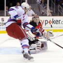 New Jersey Devils goaltender Cory Schneider makes a save as New York Rangers' Rick Nash, left, looks for a rebound during the first period of an NHL hockey game Tuesday, Oct. 21, 2014, in Newark, N.J. (AP Photo/Bill Kostroun)