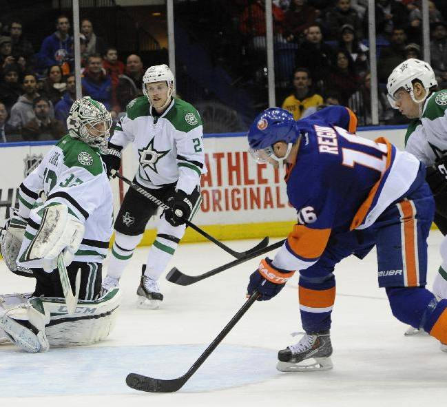 New York Islanders' Peter Regin (16) shoots the puck past Dallas Stars goalie Kari Lehtonen (32) to score in the second period of an NHL hockey game on Monday, Jan. 6, 2014, in Uniondale, N.Y