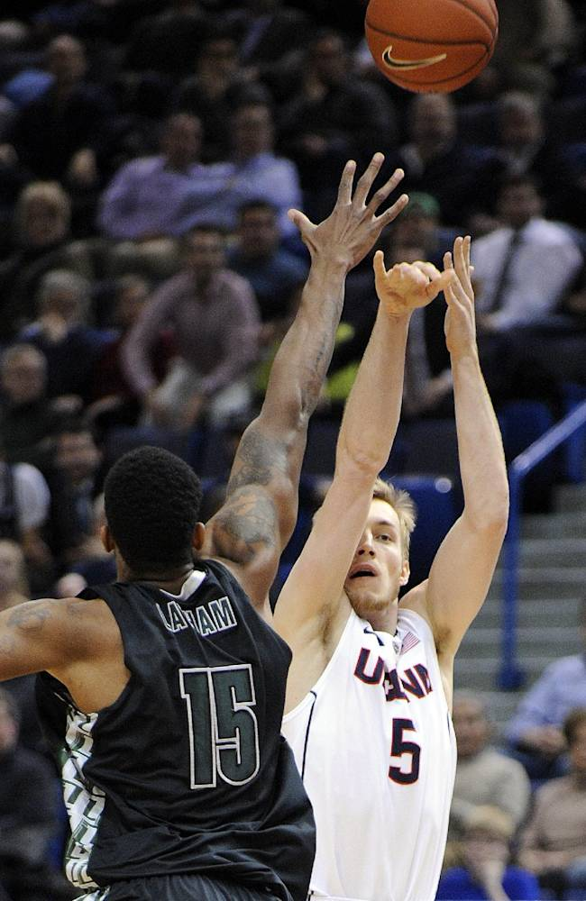 Connecticut guard/forward Niels Giffey (5) shoots over Loyola, Maryland forward Jordan Latham (15) during the first half of an NCAA college basketball game, in Hartford, Conn., on Tuesday, Nov. 26, 2013