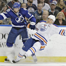 Tampa Bay Lightning center Alex Killorn (17) takes down Edmonton Oilers defenseman Andrew Ference (21) during the second period of an NHL hockey game Thursday, Jan. 15, 2015, in Tampa, Fla The Associated Press