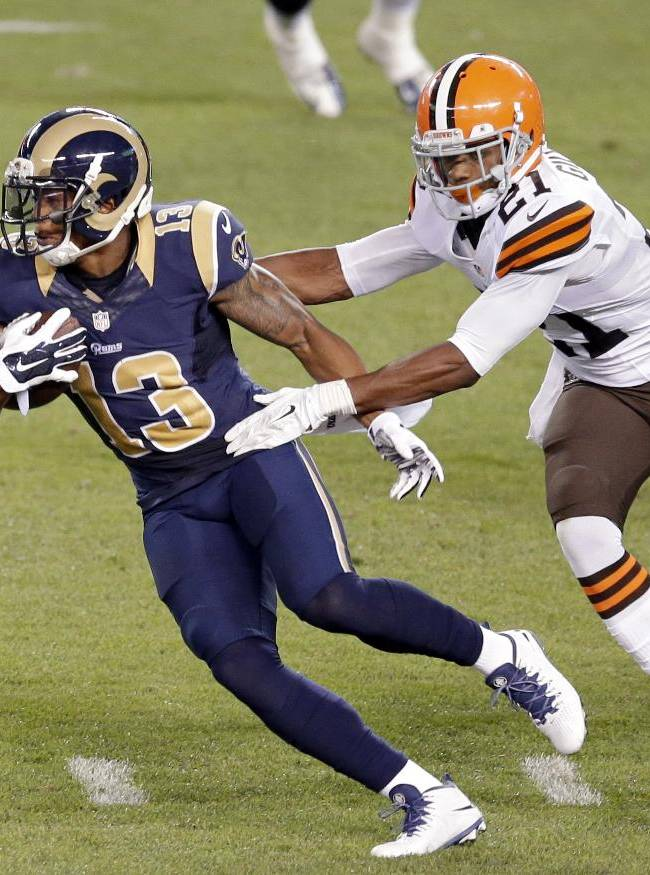 In this Aug. 23, 2014, file photo, St. Louis Rams wide receiver Chris Givens (13) slips away from Cleveland Browns cornerback Justin Gilbert (21) on a 75-yard touchdown catch in the second quarter of a preseason NFL football game in Cleveland. Despite an atrocious performance in their third exhibition game, the Browns believe there's time to correct their mistakes before the Sept. 7, season opener at Pittsburgh