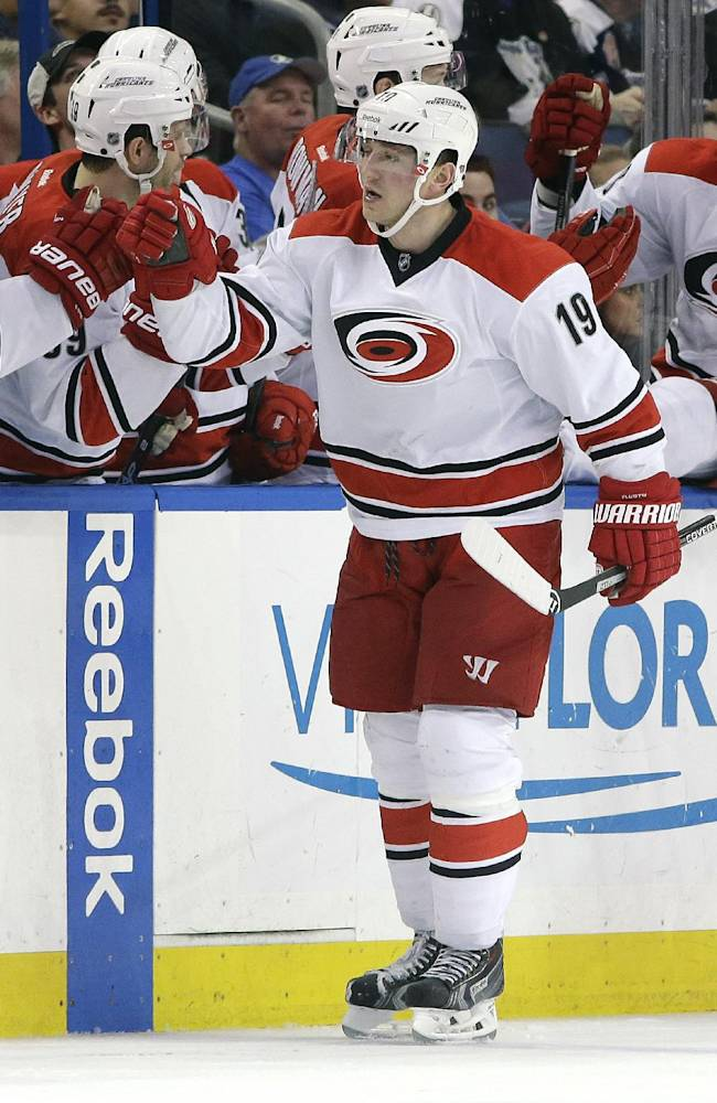 Carolina Hurricanes left wing Jiri Tlusty (19), of the Czech Republic, celebrates with teammates on the bench after scoring against the Tampa Bay Lightning during the second period of an NHL hockey game Saturday, Dec. 21, 2013, in Tampa, Fla