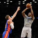 Brooklyn Nets' Joe Johnson (7) takes aim over Detroit Pistons' Jonas Jerebko (33) in the first half of an NBA basketball game on Friday, April 4, 2014, in New York The Associated Press