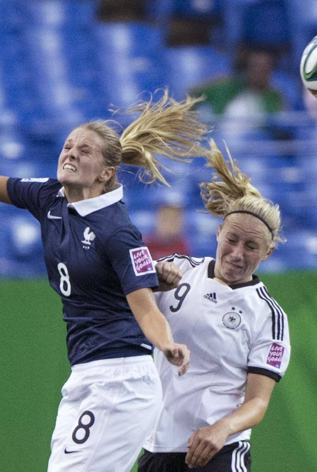 France's Sandie Toletti heads the ball away from Germany's Pauline Bremer during first half FIFA U20 Women's World Cup semifinal soccer action Wednesday, Aug. 20, 2014, in Montreal