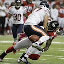 Chicago Bears free safety Chris Conte (47) defends as Atlanta Falcons wide receiver Julio Jones (11) vies for a thrown ball during the first half of an NFL football game, Sunday, Oct. 12, 2014, in Atlanta The Associated Press