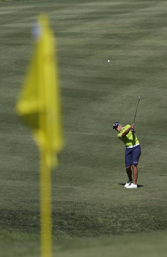 Katherine Kirk, of Australia, hits her third shot on the eighth hole during the third round of the Kingsmill Championship golf tournament at the Kingsmill resort  in Williamsburg, Va., Saturday, May 17, 2014.  Kirk bogeyed the hole
