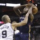 New Orleans Pelicans' Al-Farouq Aminu, right, loses the ball as he is fouled by San Antonio Spurs' Tony Parker (9), of France, during the first half of an NBA basketball game, Monday, Nov. 25, 2013, in San Antonio The Associated Press